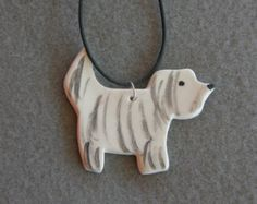 This Ceramic Pendant is part of TatjanaCeramics design and is all hand made. Being handmade each and every item is unique and one of a kind. It is made from a white clay, fron side hand painted and glazed with the translucent glaze. It is fired in a ceramic kiln at 1200 degrees Celsium. It comes with a black rubber necklace. It can be a lovely gift for a cat loving person.   Size: lenght: 6 cm (2.4), width: 5 cm (2)    More ceramic Jewelry…