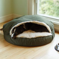 """The Snoozer Orthopedic Cozy Cave Pet Bed was designed for dogs who love to nestle under cover or beneath piles of pillows. The orthopedic cozy cave made for older dogs is topped with a raised hood that satisfies your pet's instinctive desire to burrow. A plush simulated lamb's wool interior keeps them warm throughout the year.  Features:   Poly/Cotton exterior  Sherpa interior  Machine-washable cover  3' orthopedic foam  Topped with 2""""' layer of polyester batting for added cushion and…"""