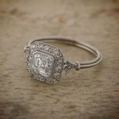 A Fascinating Vintage Asscher Cut Diamond Engagement Ring. GIA certified diamond. A BEAUTIFUL ring.