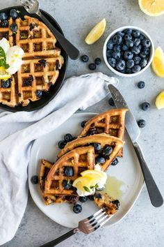 Overhead shot of two plates of waffles topped with blueberries, lemon slices, and a dollop of Greek yogurt Oatmeal Waffles, Crepes And Waffles, Blueberry Waffles, Blueberry Oatmeal, Breakfast Dishes, Breakfast Recipes, Breakfast Waffles, Brunch Recipes, Healthy Waffles