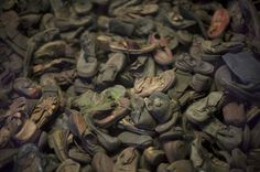 A display of childrens' shoes belonging to some of the victims of the camps. Credit James Hill for The New York Times.   Preserving the Ghastly Inventory of Auschwitz - NYTimes.com