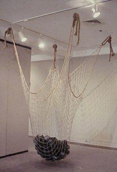 Hanging Nest 10'x10'x9', Unglazed Earthenware ceramics, nylon net, rope. [Installed 2001 Durham Art Guild, Durham, NC]