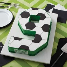 Celebrate your team's big win with this Go for the Goal Soccer Cake. Made using the Countless Celebrations Cake pan Set, you can create a cake in any number (or letter) shape you'd like. Soccer Cupcakes, Soccer Ball Cake, Football Birthday Cake, 9th Birthday Cake, Soccer Birthday Parties, Soccer Party, Birthday Party Themes, Football Cakes For Boys, Soccer Theme
