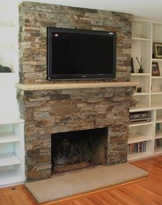 stone fireplace with mantle. I want built in shelves on the left and a built in bench storage seat on the right