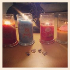 Beautiful picture of burning Diamond Candles and their rings
