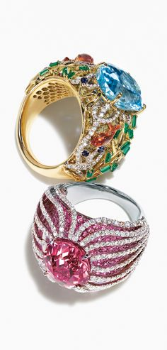 An 8.83-carat aquamarine and a 7.62-carat pink spinel serve as the centerpieces for rings inspired by the colorful life below the surface of the sea.