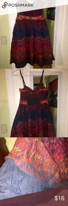 """Aryeh Dress Blue, Red, Adjustable Straps NWOT; beautiful but never worn. The colors include a rich navy, red, and orange. Boning in the corset and a pseudo-petticoat in navy under the dress that serves as a lining. Length of straps is adjustable.  The approximate dimensions of the dress (lying flat, on one side of the garment) are: Width at waist -- 14.5"""" -- 16"""" (there is stretch here due to the elastic on the back) Width at bust -- 16"""" -- 18"""" (also some stretch) Length, lowest point of…"""