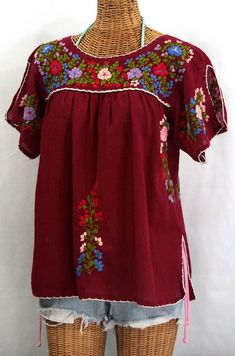 Gorgeous split-sleeve Mexican blouse peasant top, $52.95.  Crochet trim all around with a vented bottom hem.