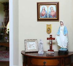 You don't need a lot of room to set up an altar to Mary in your home. All you need is one area to place your favorite devotionals such as statues, pictures, a crucifix, or rosary beads. Some of our favorite altar pieces include: Home Altar Catholic, Altar Design, Prayer Corner, Prayer Room, Chapelle, Home Room Design, Gallery Wall, Illustration, Home Decor