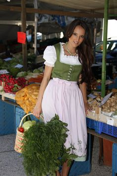 farmer's market run in traditional dirndl fok dress, Germany