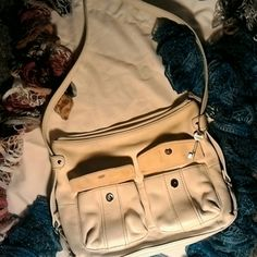 Large white leather Fossil handbag with Key Large genuine leather fossil handbag with key. Barely used. White just isn't  my friend...... Fossil Bags Shoulder Bags