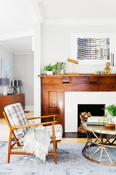 Mantle Makeover: How To Give Your Hearth a New Look // mantle decorating ideas, Danish armchair, brass coffee table