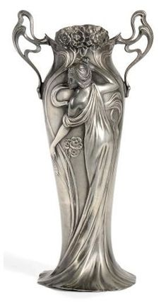 A WMF ART NOUVEAU PEWTER TWIN-HANDLED VASE CIRCA 1906 decorated in relief with two Art Nouveau maidens and sinuous handles, stamped maker's marks (without glass liner)