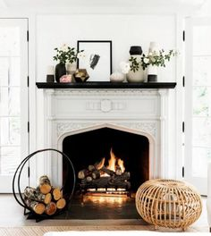 I would add some colour to the walls and decor to accentuate the intricacies of the fire place