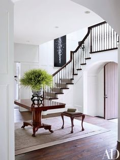A circa-1830 Swedish pedestal table topped with a Ming-dynasty jar centers the entrance hall of a Washington, D.C.–area house by interior designer Darryl Carter and architect Donald Rococo | archdigest.com