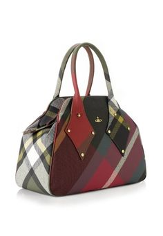 Produced in Vivienne Westwood's classic Mac Bruce tartan, this bag is the perfect staple wardrobe must-have. The instantly recognisable Yasmine shaped bag is finished on the front with the delicate golden Orb. Lined in Vivienne's grey scribble Orb fabric, the bag comes with one zip closing compartment and two open pockets.