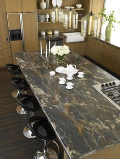 This laminate countertop mimics granite, with swirls of blue, brown and gold, and exotic veining. Some finishes feature subtle clefts and fissures for added realism. Shown: 180fx Blue Storm. Photo courtesy of Formica Corporation
