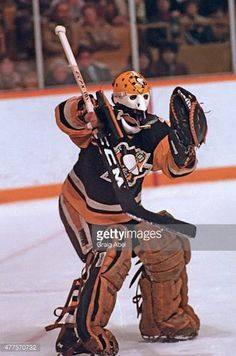 michel-dion-of-the-pittsburgh-penguins-stops-a-shot-against-the-at-picture-id477570732 (405×612) Hockey Helmet, Hockey Goalie, Hockey Teams, Ice Hockey, Pittsburgh Penguins Goalies, Nhl, Goalie Mask, Hockey Stuff, Masks Art