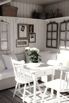 Enclosed porch with plank walls, shelf all the way around..love the use of vintage windows as wall decore!