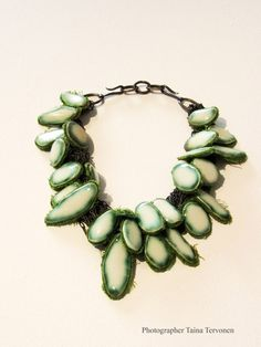 Terhi Tolvanen ~Mossy green 2007. Necklace Ø 19 cm. Porcelain, textile, silver, steel. Private collection.