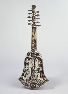 "1700 German (Hamburg) Bell cittern (back view) at the Victoria and Albert Museum, London - From the curators' comments: ""The bell cittern or cithrinchen, as it is known in Germany, was a smaller version of the cittern, a popular instrument associated with taverns and barbers' shops, and it enjoyed a vogue from about 1650 until 1720. It was either strummed with a plectrum or played with fingers like a baroque guitar, the latter practice being widespread in Holland."""