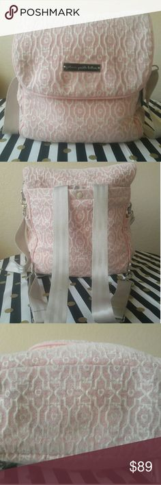 Pink Chenille Petunia Pickle Bottom Fashionable and functional! This bag has lots of space and pockets for everything a mom would need including a attached changing pad. There are some signs of wear on the bottom and corner (see picture). Please contact me for more pictures. Petunia Pickle Bottom Bags Baby Bags