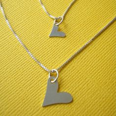 Mother Daughter heart necklaces - Big Sister Little Sister matching necklaces - Valentine's Day gift. $48.00, via Etsy.