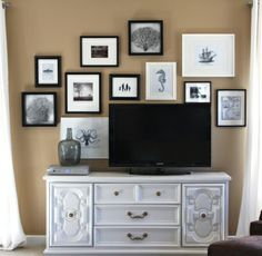 black & white images in black gallery frames help to lessen the impact of the 'big black box'... I'd like to try this layout with a few black mats, too.
