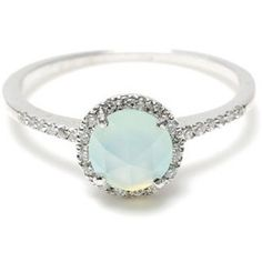 Now you can carry your obsession with pastel teal with you forever with this mint Opel engagement ring.