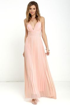 Deeper than the deep blue sea and the Grand Canyon combined ... that's how deep our love for the Depths of My Love Peach Maxi Dress is! Elegant chiffon in a lovely peachy pink hue shapes a triangle bodice and sultry V neckline supported by crisscrossing, adjustable spaghetti straps. The fitted, pintucked waistline accentuates your figure before flowing into an accordion pleated maxi skirt. Hidden back zipper and clasp.