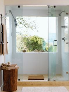 glass shower with a stone floor