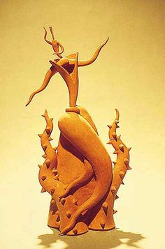 """Dancing through the Forest of Thorns""  Ceramic Teapot    Created by Michael Torre  Sculptural teapot made of unglazed red clay. Nonfunctional."