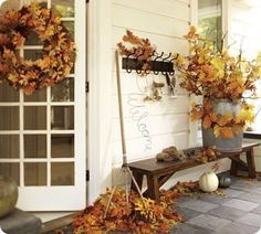 Fall front porch ideas = love this bench and the hooks! I have an empty corner of my porch and this might be perfect.