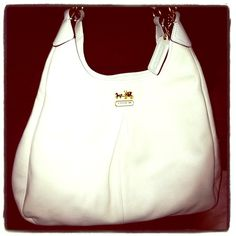 COACH white purse Used for a couple of months. Mint condition. More pics available upon request. Coach Bags