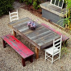 Small yard, rustic benches and mismatched chairs