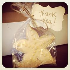 Beach themed bridal shower. Favors for guests. Starfish cookie with brown sugar as sand.
