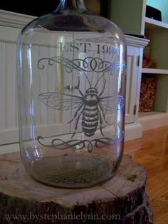 How to turn a glass jug into a beautiful gift with vinyl and a cutter.