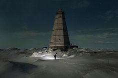 Slava walks to the old lighthouse near Khodovarikha