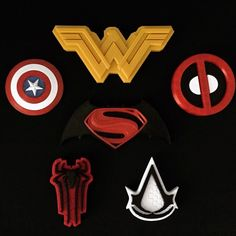 Our captain America, dead pool, Wonder Woman, assassins creed and batman vs superman 3D printed logos.  -Forg3d props