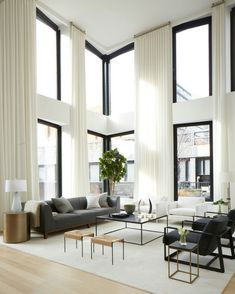 Soaring ceilings, white draperies and dark furnishings.