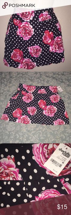 🌺 Charlotte Russe Polka Dot Floral Mini Skirt 🌺 Brand new with tags. Very pretty. Polka dots and flowers. Skirt stretches in the back. Charlotte Russe Skirts Mini