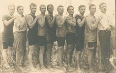 10 men on the beach, early 1920s