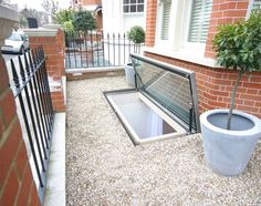 Opening hinged escape rooflight - Replacement of an existing poorly performing basement fire escape at the front of a period house. 2.6m by 1.1m. See more at meia.co.uk