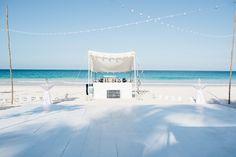 Beachfront bar and dancefloor for the perfect destination reception.