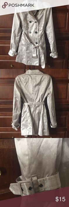 """NWOT Charlotte Russe Silver Trench Coat Size M Never worn. Been buried in my closet - just wrinkled. Front pockets and belt. 19"""" armpit to armpit. 14"""" across waist. 31"""" in length. Charlotte Russe Jackets & Coats Trench Coats"""