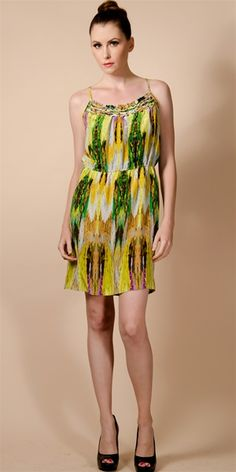 This silk printed dress features a pieced yoke with mini ruffle and braided detail. Elastic gathers at waist.Curved side pockets. Adjustable spaghetti straps. Lined at bust.100% silkDry clean only