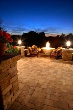 Patio and fire pit featuring Olde Quarry® and Brussels Block® paver