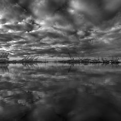 The cloudy remnants of a hurricane float past Fish Harbor.