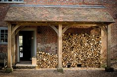 Double function porch and log store - brilliant! House With Porch, House Front, Ivy House, Farm House, Log Shed, Log Store, Firewood Storage, Back Doors, Porches