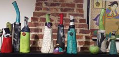 """Handbuilt, raku fired clay bottles by Florida artist, JoAnne Bedient. From her """"Peoples is Peoples"""" bottle series Fire Clay, Bottles, Florida, Ceramics, Spaces, Artist, Home Decor, Ceramica, Pottery"""